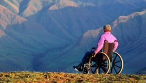 traveler on wheelchair in mountains